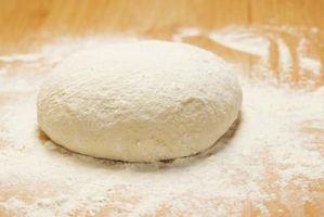 Por Soco para baixo da massa de pão e deixe crescer novamente?